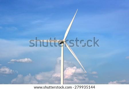 Wind Turbine in blue sky  - stock photo