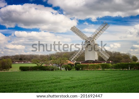 Windmill on a sunny day in the norfolk broads of england.