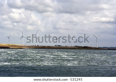 6 windmills on the seaside shore.