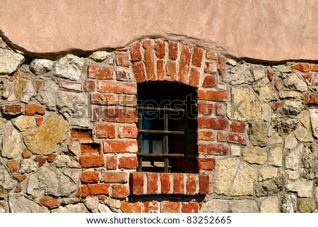 Window of a medieval building, very old brick wall. Sandomierz, Poland. - stock photo