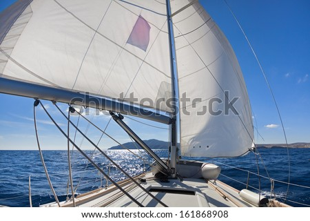 """""""Wing and wing"""" sailing on the yacht during the regatta near greek islands  - stock photo"""