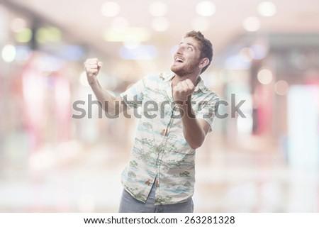 winner ginger young man with hawaiian shirt - stock photo
