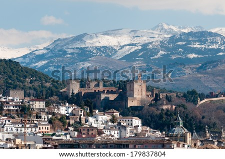 Winter view of famous Alhambra in front of Sierra Nevada, Spain. - stock photo