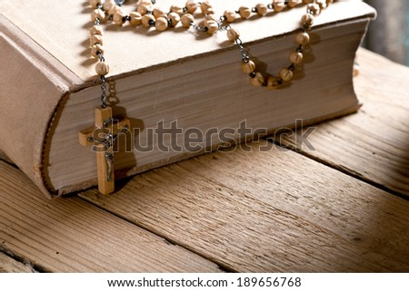 with bible and prayer beads