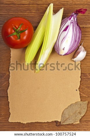 (with space for text) vegetables - tomato, celery and onions on  wooden board - stock photo