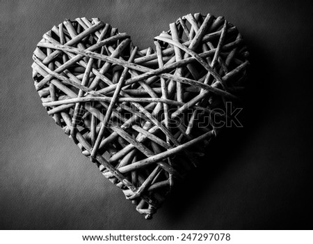 (withe, withy, osier, sallow, vine) braided on a frame in the form of hearts on a background of cardboard, BW photo - stock photo