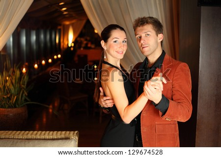 woman and a man dancing in the restaurant - stock photo