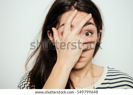 Woman covers his face by hand