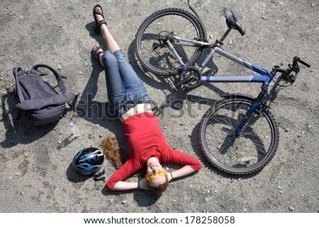 woman  cyclist resting near bike in summertime - stock photo