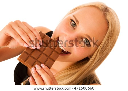 woman eats chocolate isolated over white background