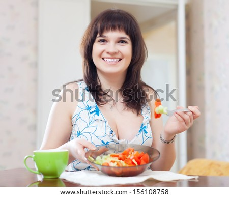 woman eats vegetarian salad at home