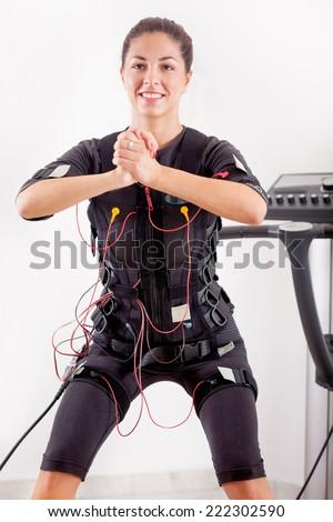 woman exercise key position on electro stimulation machine - stock ...