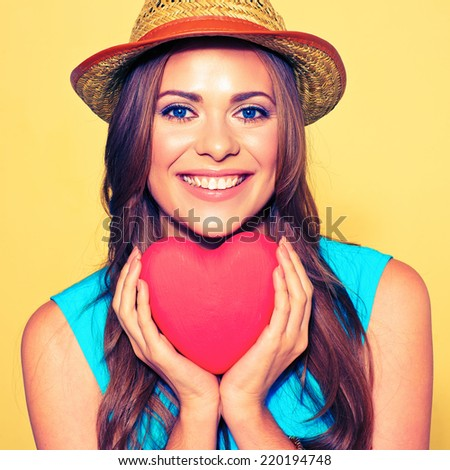 woman face portrait. model  holding red Heart. Love symbol. - stock photo