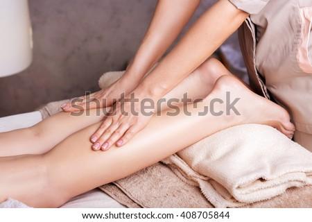 Woman having sports foot massage in Spa Salon   - stock photo
