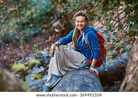 woman hiking in beautiful forest - stock photo