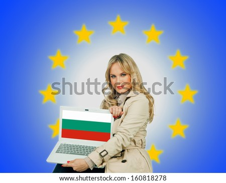 woman holding laptop with bulgarian flag on the screen and european union stars in the background - stock photo