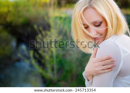 woman in a spring park. close-up - stock photo
