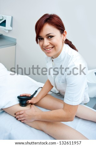 woman in beauty salon on localized anti fat treatment therapy