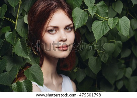 woman in green leaves