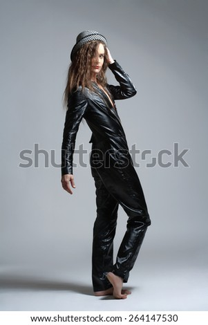 Woman in Leather Dress and Hat Looking - stock photo