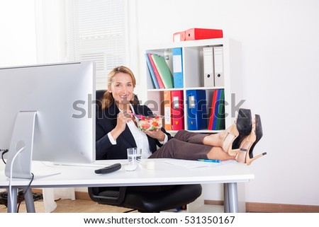 woman in office who eats feet on the desk