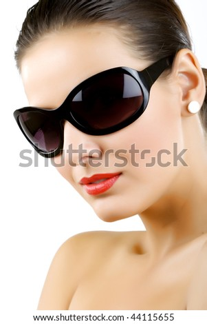 Woman in sunglasses glamour portrait over white