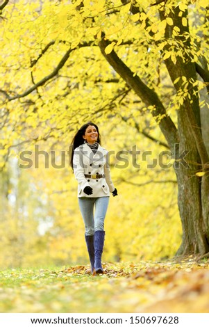 woman in yellow autumn park - stock photo