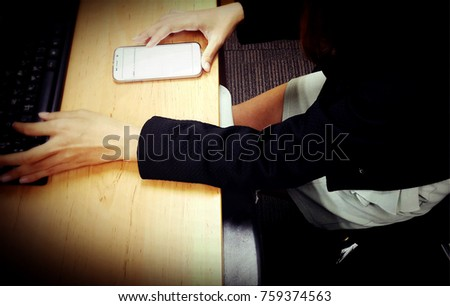 Woman is playing cell phone.