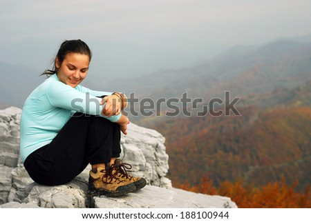 woman on the top of the mountain - stock photo