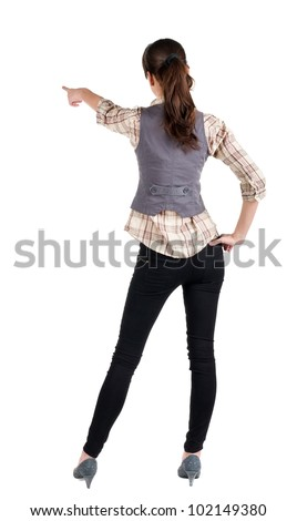woman pointing. Back view . beautiful brunette girl in shirt gesture.  Rear view people collection.  backside view of person.  Isolated over white background. - stock photo
