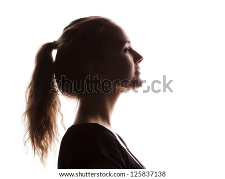 woman portrait profile  in silhouette shadow on studio isolated white background - stock photo