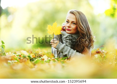 woman portret in autumn leaf close up - stock photo