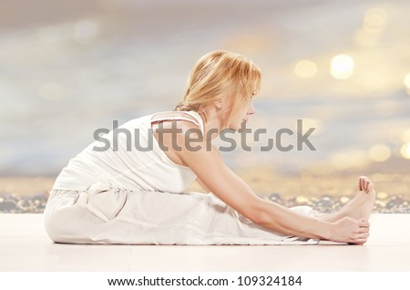 woman practising yoga exercise - stock photo