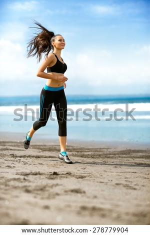 Woman running fast on beach, brunette fitness girl runner exercising outdoors on sea background.  - stock photo