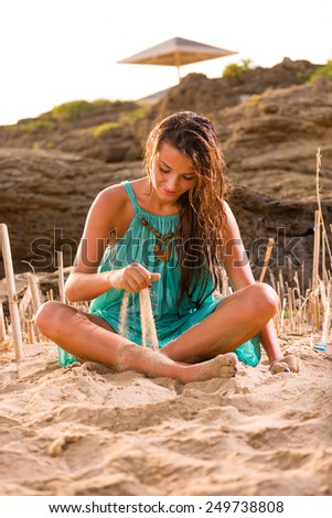 woman sitting on the beach sand