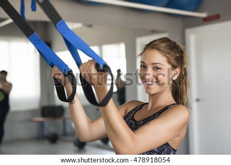 WOman smiling training in gym