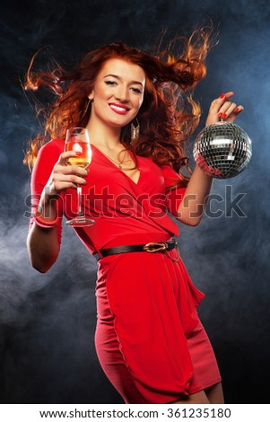 woman with a glass of white wine and disco ball - stock photo