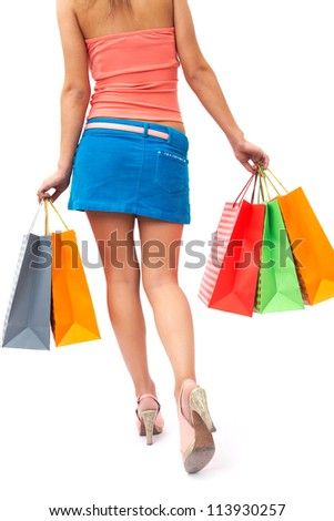woman with beautiful legs is shopping bags in hand