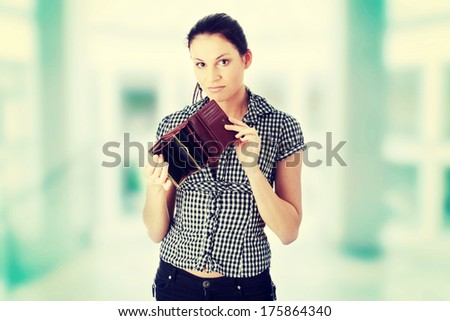 Woman with empty wallet - broke  - stock photo