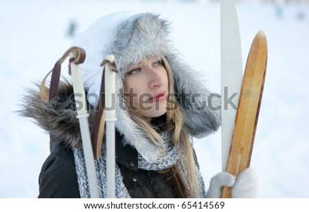 woman with ski over winter background - stock photo