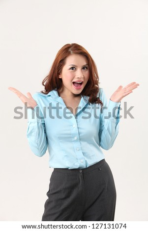Woman with surprised expressionon the white background - stock photo