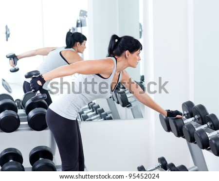 woman with weight training equipment on sport gym club