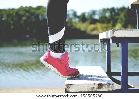 woman working out in the park  - stock photo