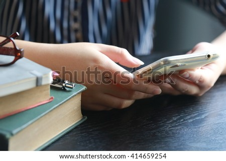 women reading book and use phone - stock photo
