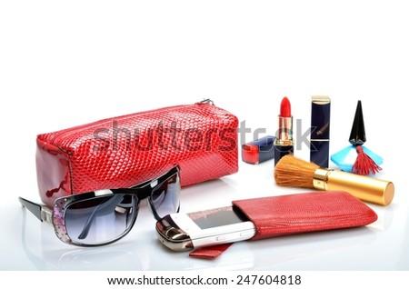 Women's accessory: sunglasses, cosmetic bag, mobile phone in still life - stock photo