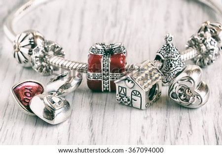 Women's Bracelet Pandora, Charms close-up, jewelry, vintage - stock photo