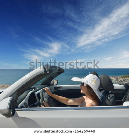 Women traveling in a convertible on Resorts