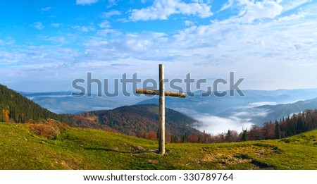 Wood cross on fall mountain plateau. Four shots composite picture. Jaremche Town outskirts, Ivano-Frankivsk Region, Ukraine. - stock photo