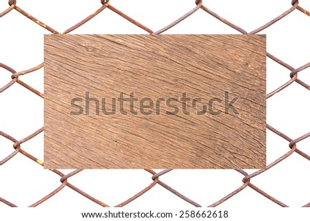 wood on the cage metal net - stock photo