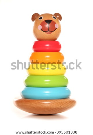 Wooden bear stacking toy white background - stock photo